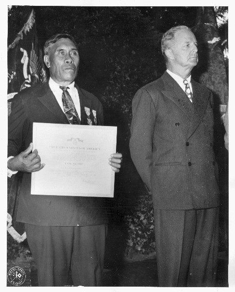 Benjamin Kanahele, of Niihau, Hawaii, displays the Medal for Merit and Purple Heart awarded to him for killing a Japanese pil