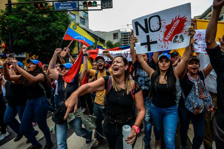 Opposition activists shout slogans in the capital of Caracas on May 7.