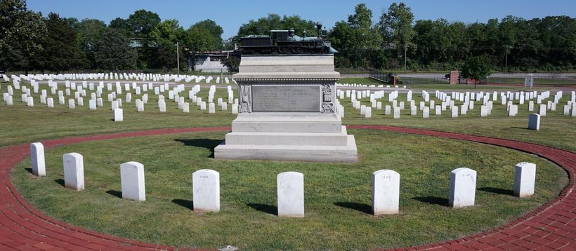 The eight executed raiders are buried in a semicircle around the monument.