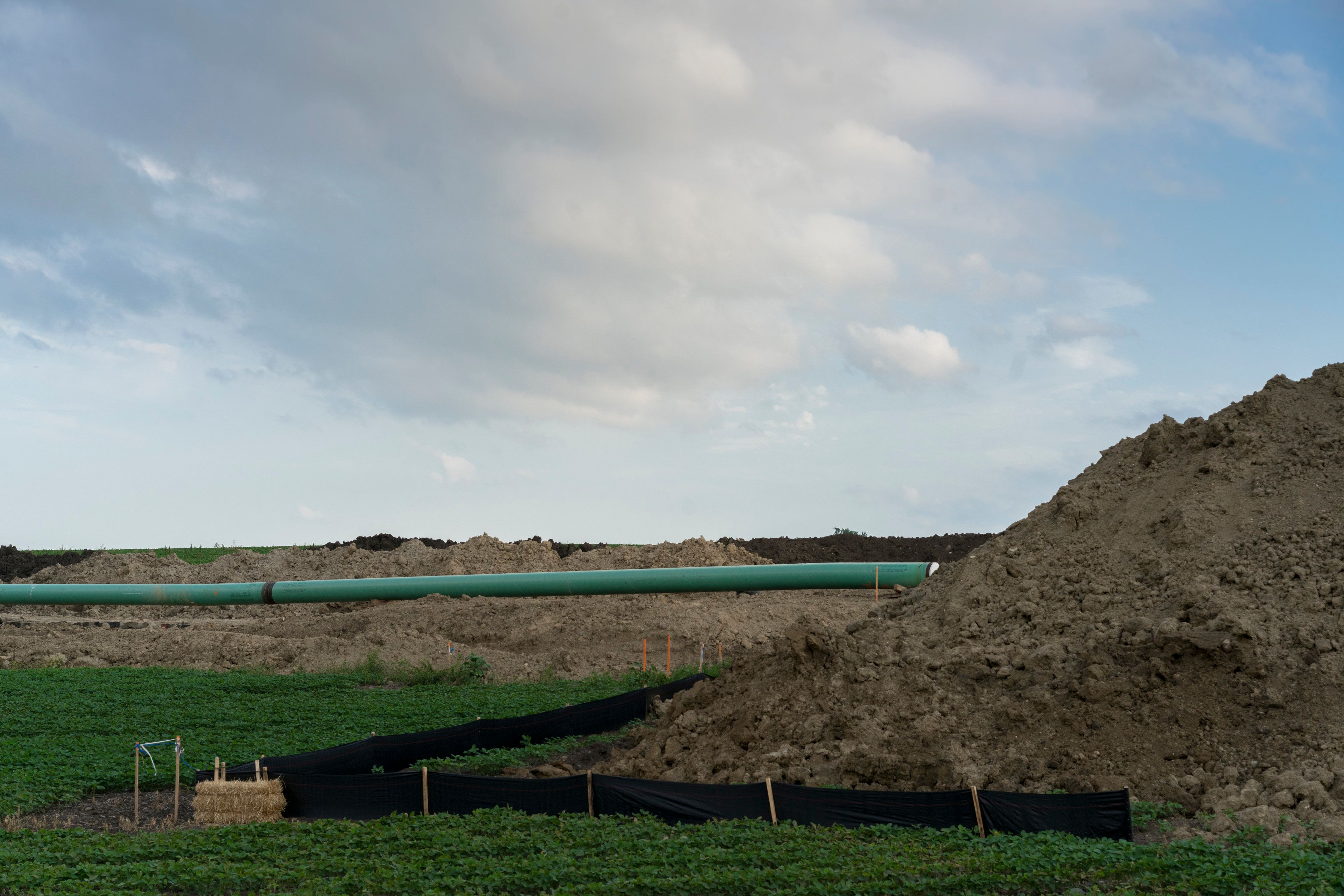 Dakota Access Pipeline being constructed through farmland near Sioux Falls, SD. The Dakota Access Pipeline Project is a new approximate 1,172-mile, 30-inch diameter pipeline that will connect the rapidly expanding Bakken and Three Forks production areas in North Dakota to Patoka, Illinois.