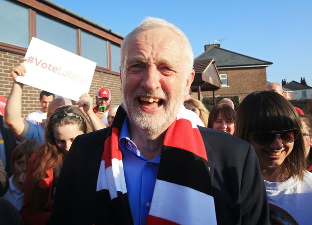 Labour leader Jeremy Corbyn wears a Rotherham United scarf after making a speech on the general election...
