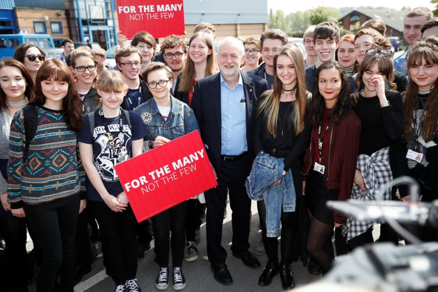 Jeremy Corbyn poses for a picture with first time voters at a campaign event in Garfoth,