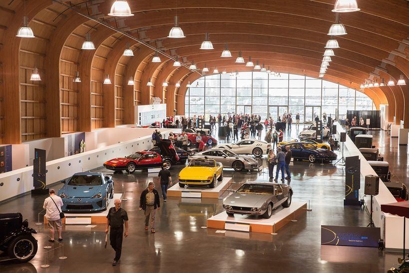 A crowd appreciates the supercars and hypercars at the new Exotics @ ACM exhibition at America's Car Museum in Tacoma, Washin