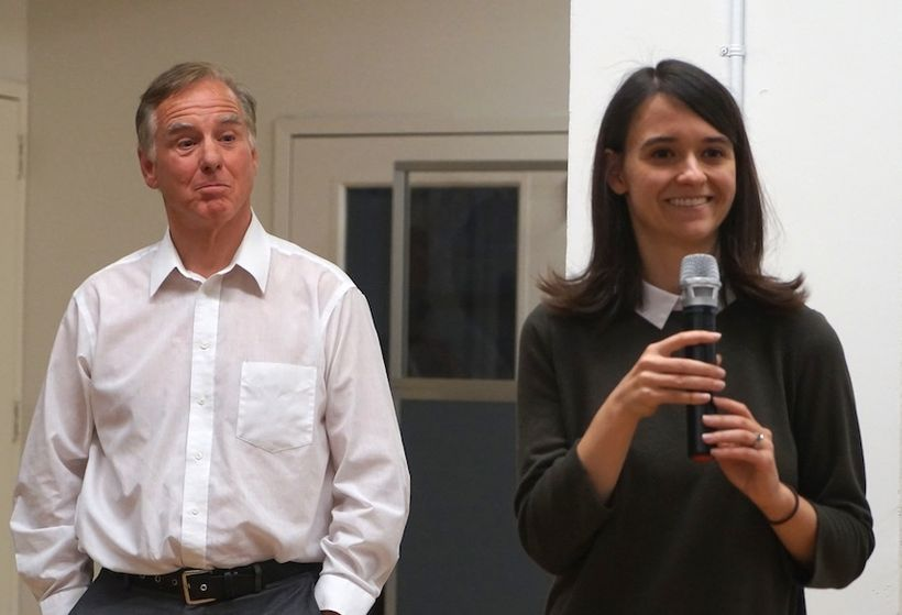 Howard Dean listens as Leah Greenberg, co-founder of Indivisible speaks to the crowd at Knotel on 26th street.