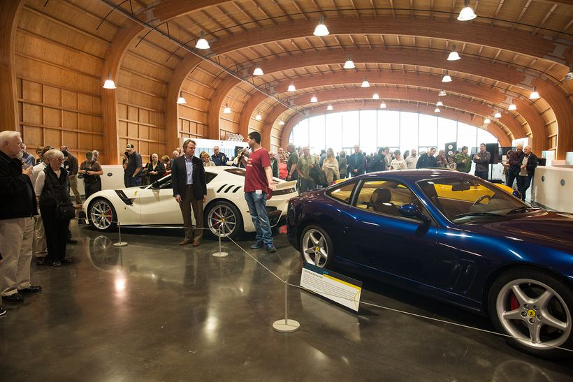 America's Car Museum Curator of Exhibitry Scot Keller helps introduce the Ferrari F12tdf at the opening of Exotics @ ACM in T
