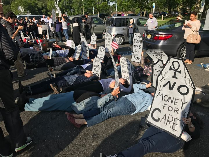 "Demonstrators hold a ""die-in"" outside the town hall Rep. Tom MacArthur held in New Jersey on Wednesday."