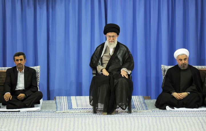 <em>Iranian supreme leader Ayatollah Ali Khamenei (center) during a ceremony officially endorsing moderate cleric Hassan Rowh