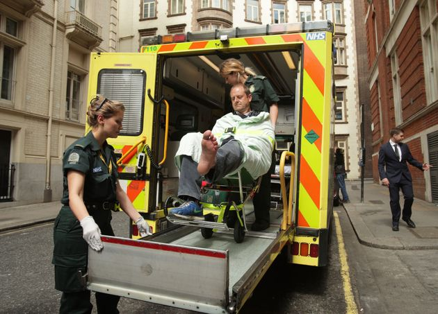 BBC cameraman Giles Wooltorton is loaded into an ambulance after the car carrying Jeremy Corbyn...