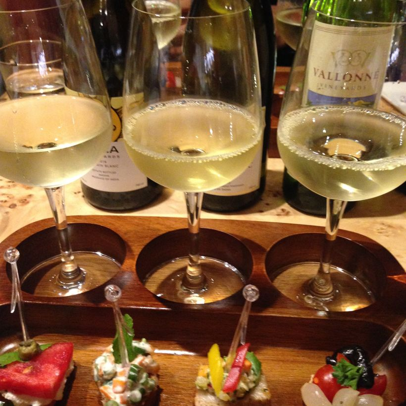 A trio of white wine from Nashik paired with appetizers at the Gateway Hotel Ambad