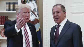 WASHINGTON, D.C., USA - MAY 10, 2017: President Donald Trump (L) of the United States and Russia's Foreign Minister Sergei Lavrov during a meeting in the Oval Office at the White House. Alexander Shcherbak/TASS (Photo by Alexander Shcherbak\TASS via Getty Images)