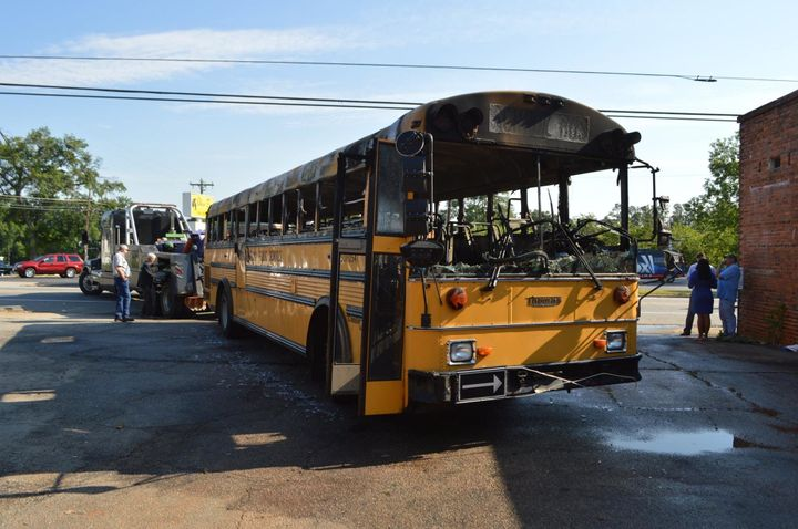 A school bus that caught fire while transporting children to school on Tuesday morning is seen.