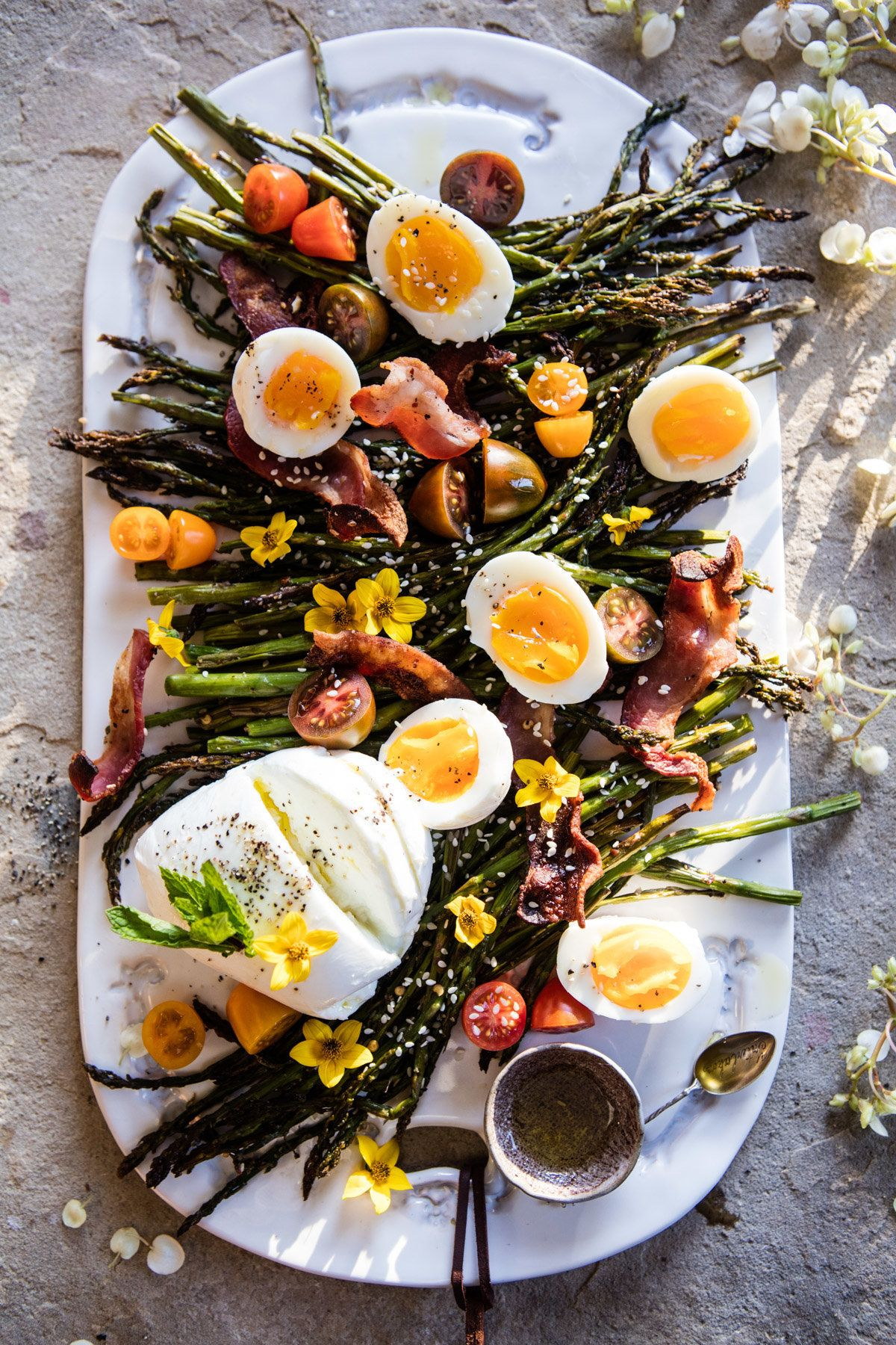 "<strong>Get the <a href=""https://www.halfbakedharvest.com/sesame-roasted-asparagus-egg-and-bacon-salad/"" target=""_blank"">Sesa"