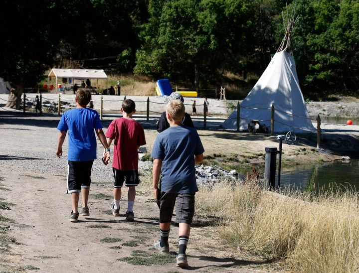 Boy Scouts walk around camp Maple Dell on July 31, 2015 outside Payson, Utah.