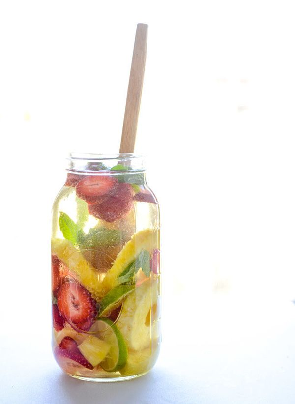 """<strong>Get the <a href=""""http://www.howsweeteats.com/2015/03/pineapple-sangria/"""" target=""""_blank"""">Pineapple Sangria recipe</a>"""