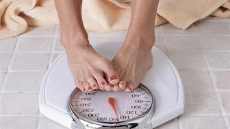 Photo of woman's feet on scale.