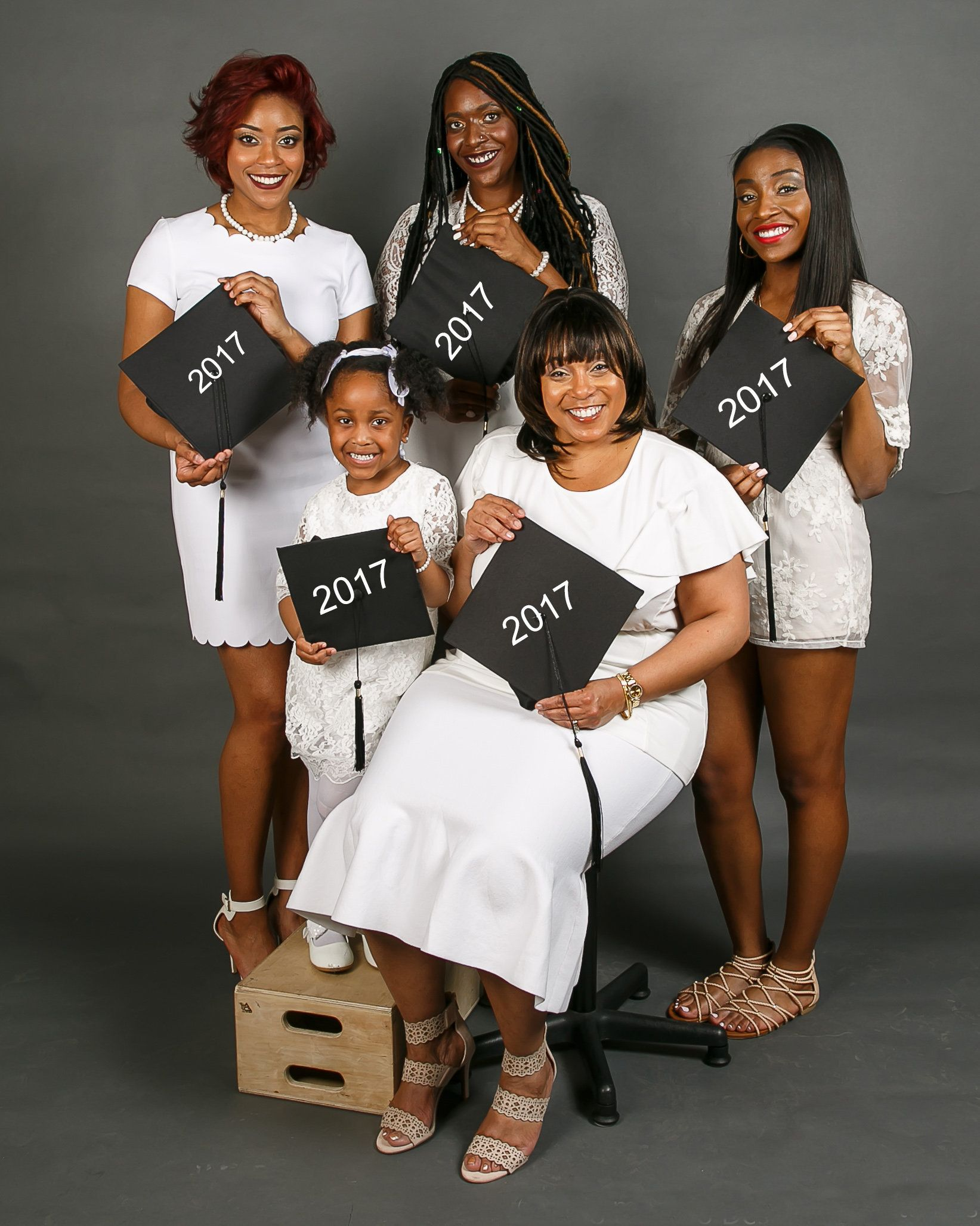 From left to right, Amari, Paris and Jade stand behind Flennoy and her granddaughter.