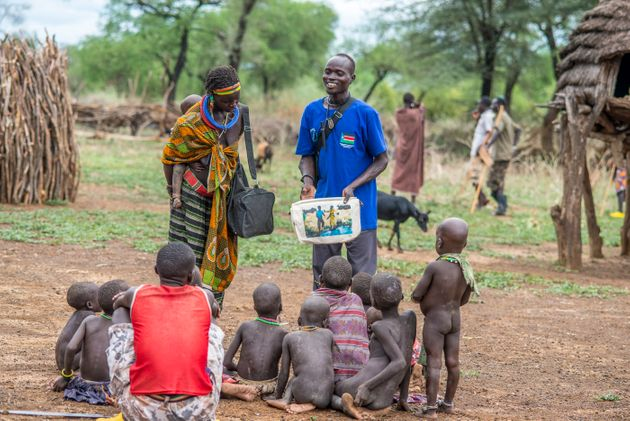 A health worker in South Sudan uses a picture book to teach children and adults how to avoid contracting...