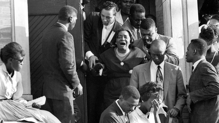 Mourners exit the funeral for the victims of the 16th Street Baptist Church in 1963.