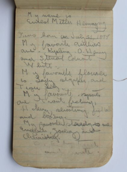 Hemingway's notebook citing his favorite authors, flower, sports and courses of study.