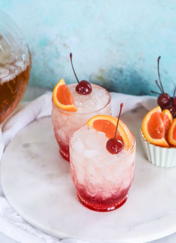 """<strong>Get the <a href=""""http://www.howsweeteats.com/2016/04/amaretto-bourbon-punch/"""" target=""""_blank"""">Amaretto Bourbon Punch"""