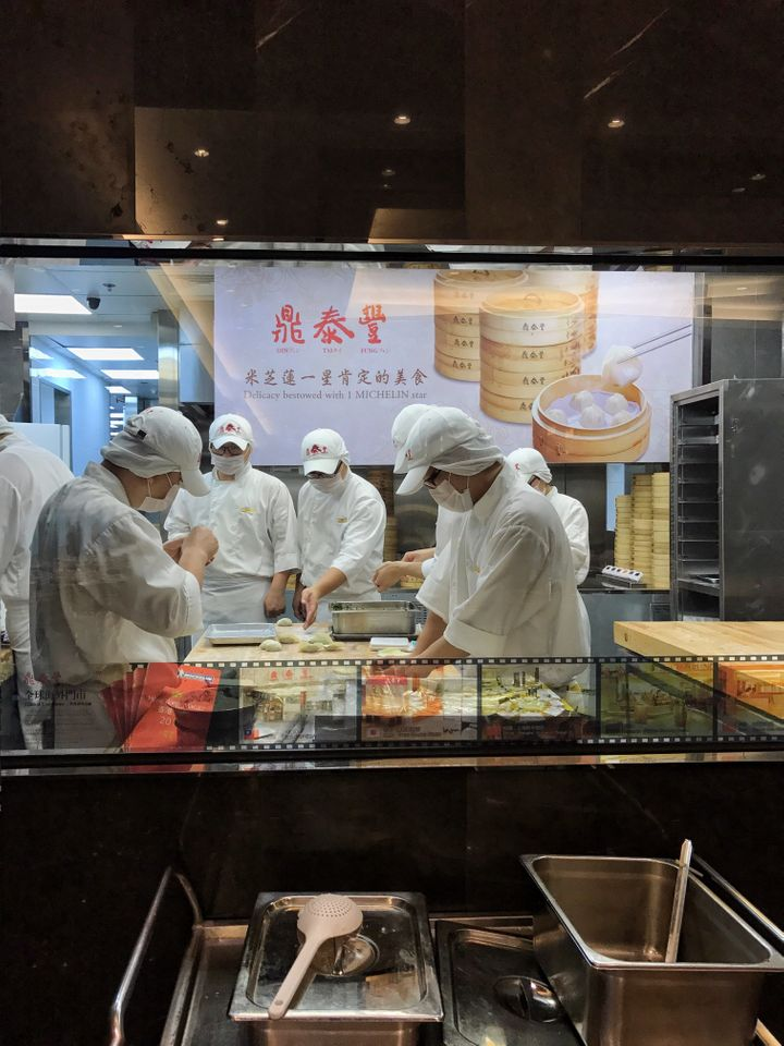 Chefs at work in the kitchen at Din Tai Fung's Miramar location in Hong Kong.