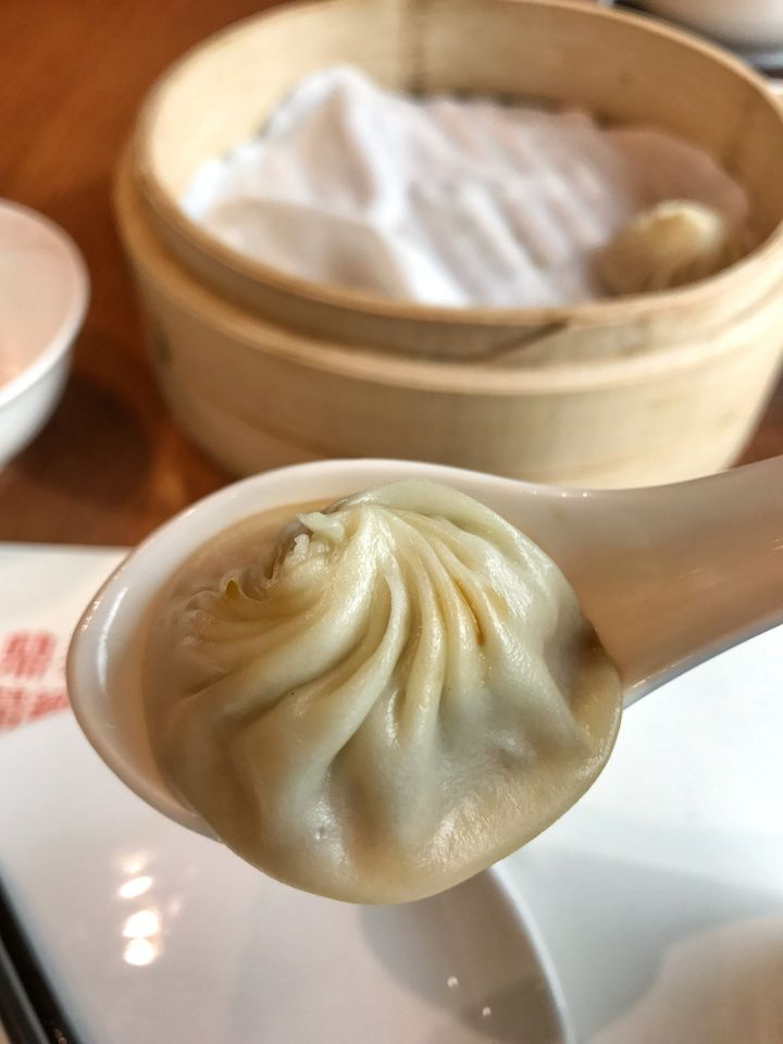 Din Tai Fungs provides customers with instructions at the table on how best to eat their xiaolongbao.