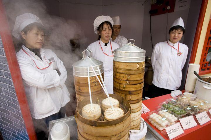 Soup dumplings stall in the Yu Garden Bazaar Market, Shanghai, China.