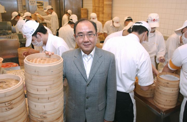Yang Chi-hua, who has been running the restaurant chain since his father retired, stands among bamboo steamers.