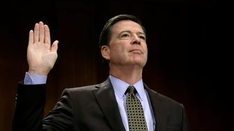 """FBI Director James Comey is sworn in to testify before a Senate Judiciary Committee hearing on """"Oversight of the Federal Bureau of Investigation"""" on Capitol Hill in Washington, U.S., May 3, 2017. REUTERS/Kevin Lamarque"""