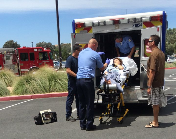 Lori being loaded on the ambulance. A fire truck from Darren's team also responded.