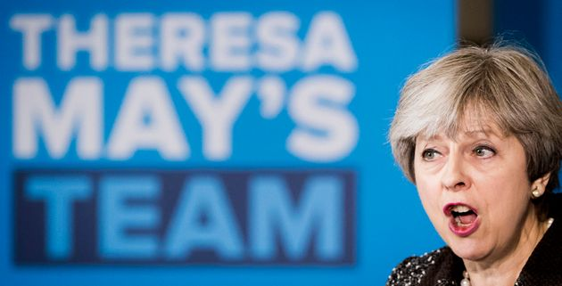 Media focus: Theresa May during a campaign visit to York Barbican this