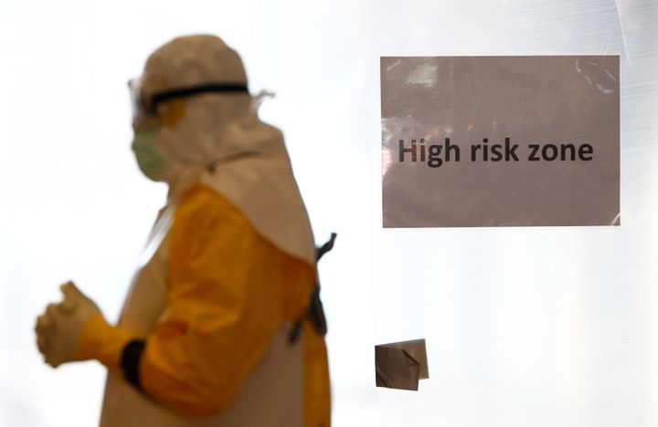 """A volunteer wearing a protective suit walks in a """"high-risk"""" zone during an Ebola training session held by Germany's Red Cros"""