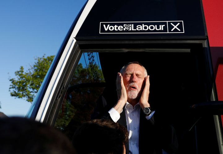 Jeremy Corbyn reacts as he gets on a bus after a campaign event in Leeds.