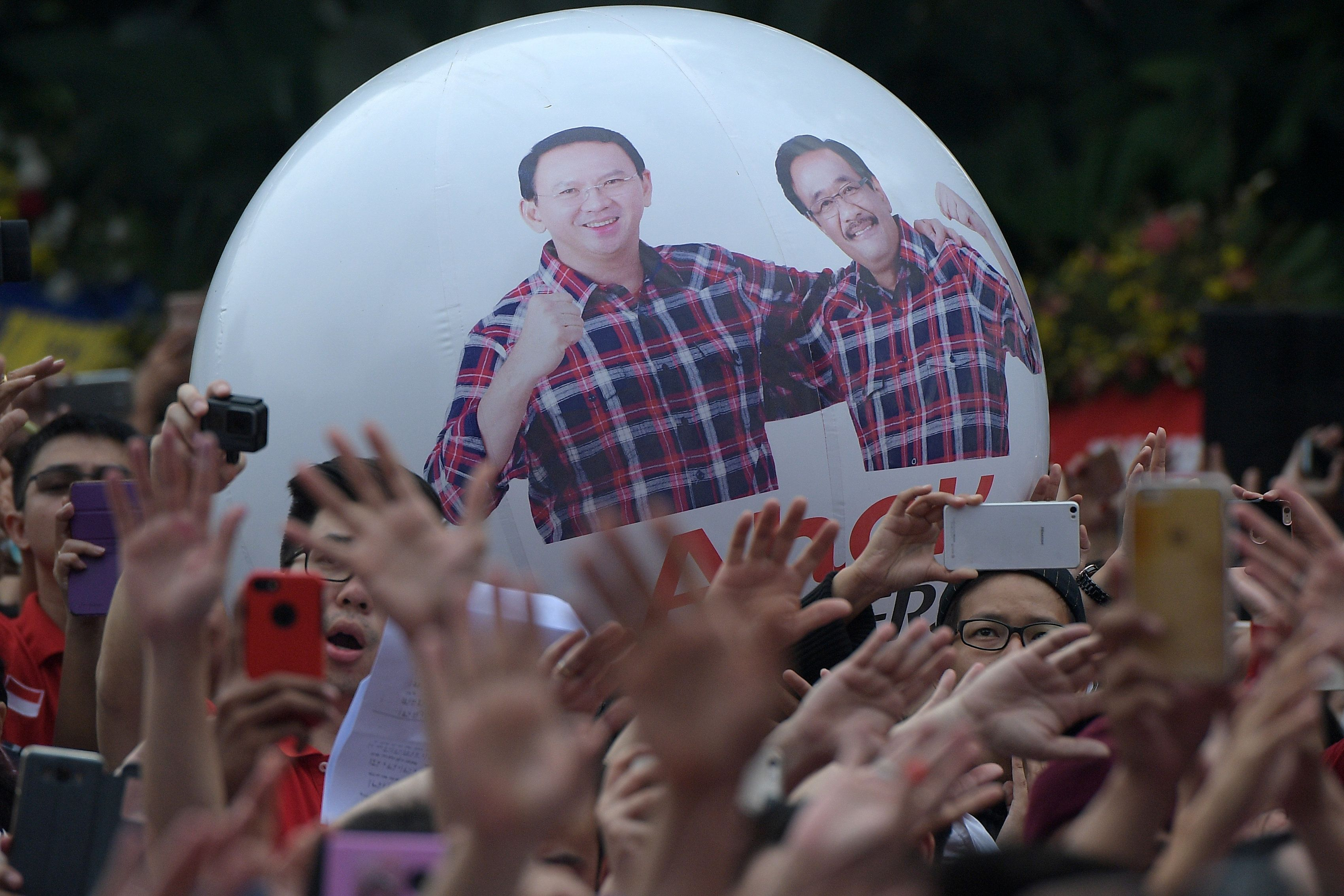 Supporters of former Jakarta governor Basuki Tjahaja Purnama, popularly known as Ahok, gather at city hall a day after after a court sentenced him to two years in jail following blasphemy charges, in Jakarta, Indonesia May 10, 2017 in this photo taken by Antara Foto. Pictured on the inflatable ball is Ahok and new acting Jakarta governor Djarot Saiful Hidayat. Antara Foto/Sigid Kurniawan/ via REUTERS   ATTENTION EDITORS - THIS IMAGE HAS BEEN SUPPLIED BY A THIRD PARTY. FOR EDITORIAL USE ONLY. MANDATORY CREDIT. INDONESIA OUT. TPX IMAGES OF THE DAY