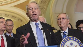 US Senator Chuck Grassley, Republican of Iowa and Chairman of the Senate Judiciary Committee, speaks alongside US Senate Majority Leader Mitch McConnell (R), Republican of Kentucky, about the vote for Neil Gorsuch to serve on the Supreme Court, at the US Capitol in Washington, DC, April 4, 2017. / AFP PHOTO / SAUL LOEB        (Photo credit should read SAUL LOEB/AFP/Getty Images)