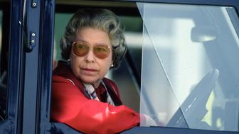WINDSOR, UNITED KINGDOM - MAY 16:  Queen Elizabeth ll drives her four wheel drive Land Rover during the Royal Windsor Horse Show on May 16, 1992 in Windsor, England. (Photo by Anwar Hussein/Getty Images)