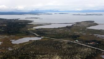 The village of Ilamna, Alaska is just a small cluster of buildings around crystal-clear Lake Iliamna, a nursery for wild salmon, which at 80 miles long is the largest U.S. freshwater lake outside the Great Lakes. (Bill Roth/Anchorage Daily News/MCT via Getty Images)