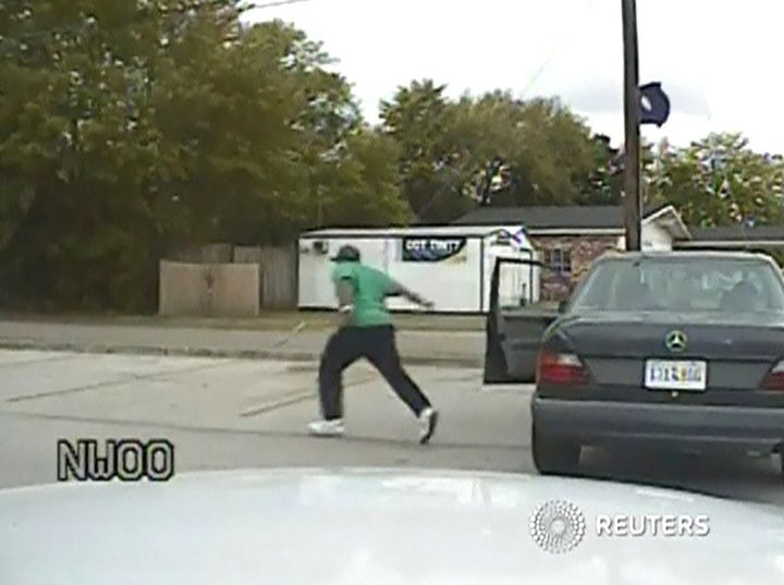 A still image taken from police dash cam video allegedly shows Walter Scott running from his vehicle during a traffic stop be
