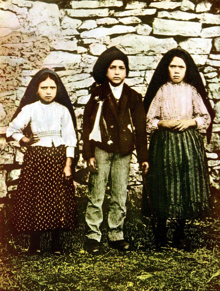 Three young shepherds, Jacinta Marto (L), Francisco Marto (C) and Lucia dos Santos who during the Spring of 1916 saw the Holy Mary over a tree in Fatima.