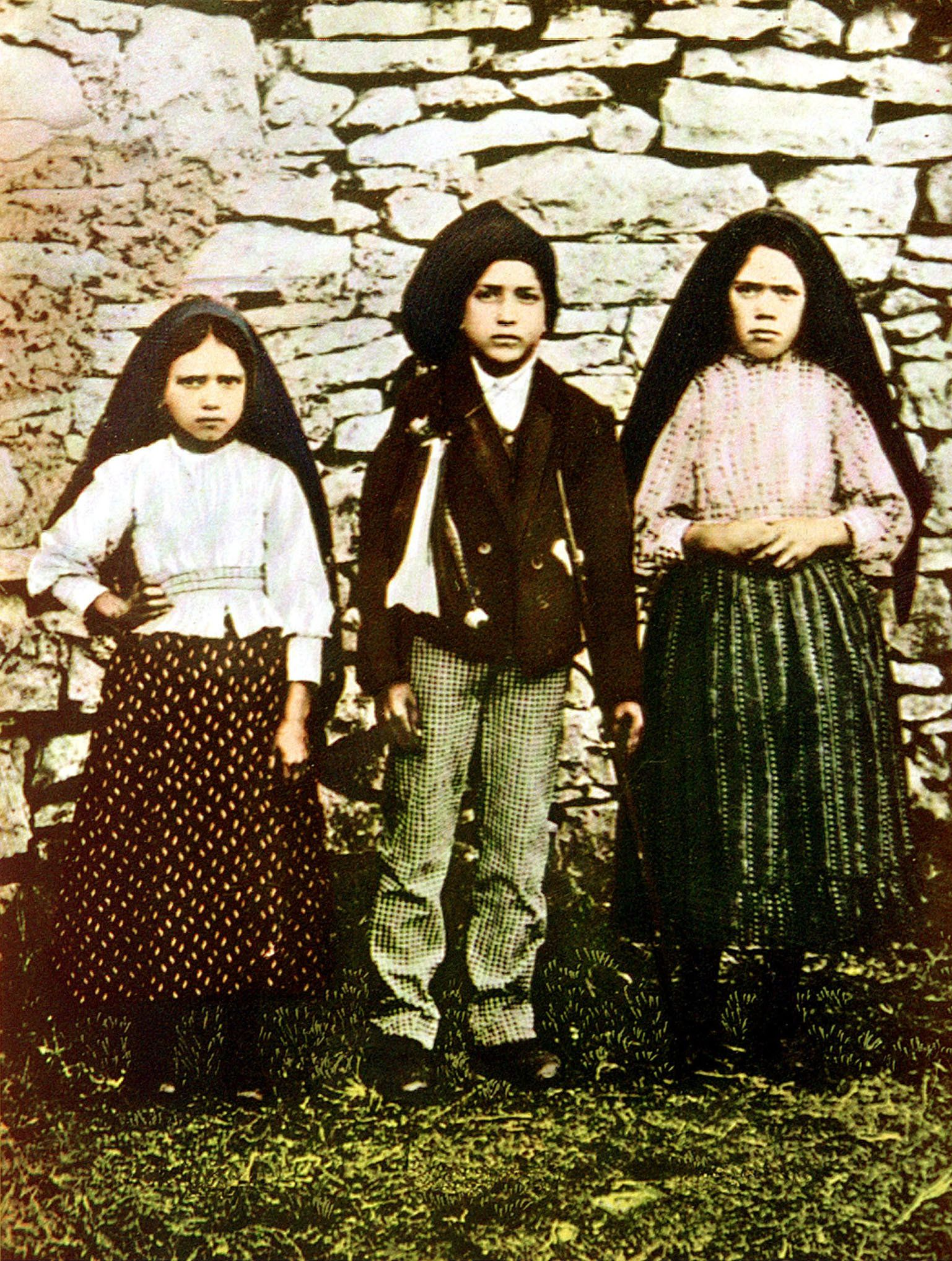 Three young shepherds, Jacinta Marto (L), Francisco Marto (C) and Lucia dos Santos who during the Spring of 1916 saw the Holy
