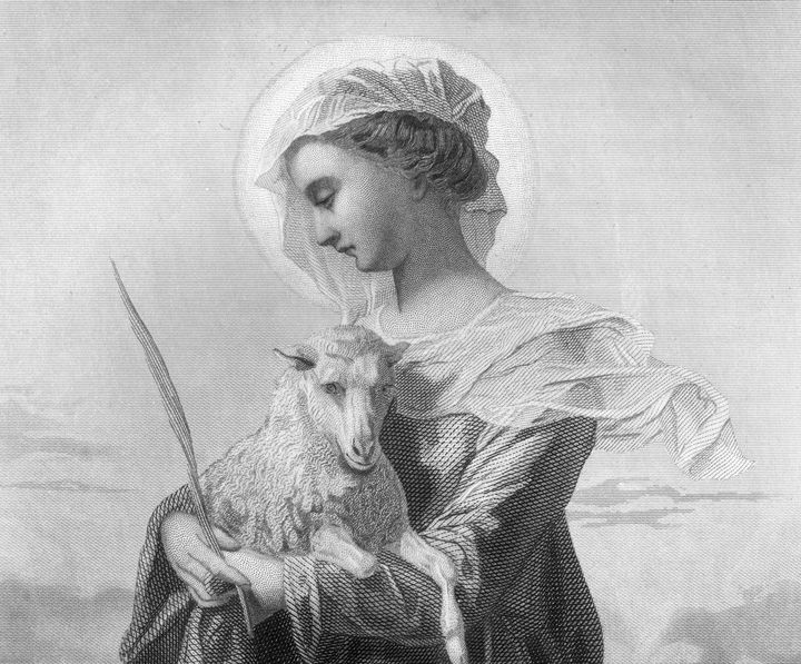 An engraved portrait of the maiden Saint Agnes (born circa 291), the patron saint of virgins, holding a lamb. She was ma