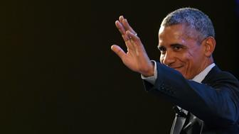 US former President Barack Obama waves at the end of his speech during the third edition of 'Seed & Chips: The Global Food Innovation Summit' focussing on new technologies for feeding the globe, from agriculture to distribution, on May 9, 2017 in Milan.  / AFP PHOTO / Andreas SOLARO        (Photo credit should read ANDREAS SOLARO/AFP/Getty Images)