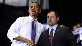 US President Barack Obama shakes hands with Congressman Tom Perriello, D-Va, during a rally in Charlottesville, Virginia, on October 29, 2010, ahead of midterms elections. AFP PHOTO/Jewel Samad (Photo credit should read JEWEL SAMAD/AFP/Getty Images)