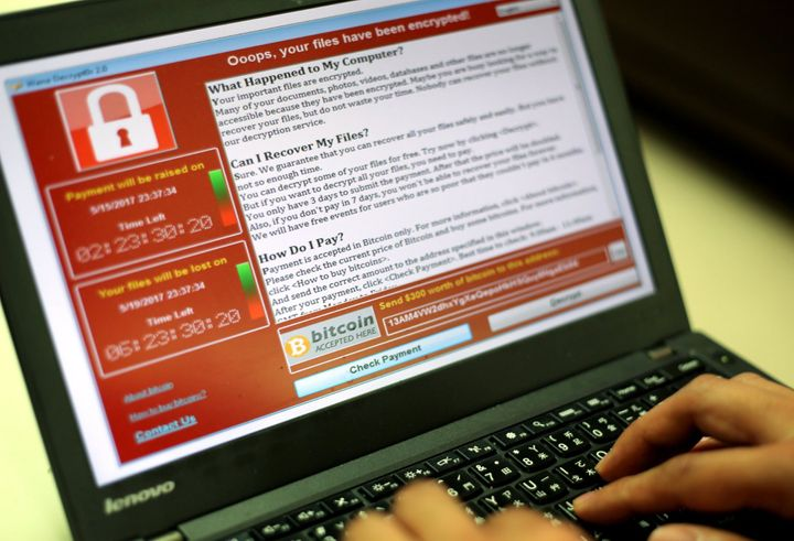 A programer shows a sample of a ransomware cyberattack on a laptop in Taipei, Taiwan, 13 May, 2017. According to news reports