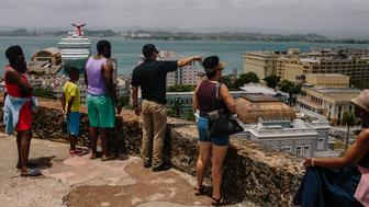 People look out over the Old City of San Juan, Puerto Rico, on Wednesday, July 8, 2015. A growing number of Republicans in the U.S. Congress are saying they want to support Puerto Rico as it wrestles with an escalating debt crisis, though they've stopped short of backing legislation allowing for municipal bankruptcy. Photographer: Christopher Gregory/Bloomberg via Getty Images