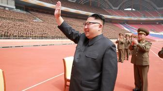 North Korean leader Kim Jong Un waves to the members of the Korean People's Army in this undated photo released by North Korea's Korean Central News Agency (KCNA) May 13, 2017. KCNA/via REUTERS  ATTENTION EDITORS - THIS PICTURE WAS PROVIDED BY A THIRD PARTY. REUTERS IS UNABLE TO INDEPENDENTLY VERIFY THIS IMAGE. FOR EDITORIAL USE ONLY. NOT FOR USE BY REUTERS THIRD PARTY DISTRIBUTORS. SOUTH KOREA OUT.
