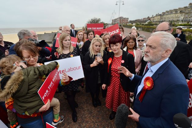 Jeremy Corbyn with Labour candidate Sonia Barker (second right) and local people on the beach at a campaign...