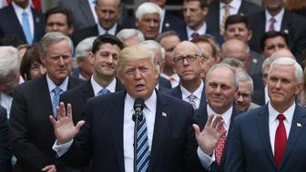 WASHINGTON, DC - MAY 04:  U.S. President Donald Trump (C) speaks while flanked by House Republicans after they passed legislation aimed at repealing and replacing ObamaCare, during an event in the Rose Garden at the White House, on May 4, 2017 in Washington, DC. The House bill would still need to pass the Senate before being signed into law.  (Photo by Mark Wilson/Getty Images)
