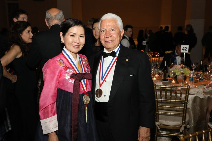 Yumi Hogan is an accomplished artist and the First Lady of Maryland pictured here with Nasser Kazeminy, the Chairman of NECO.
