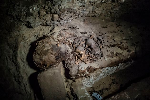 A mummy lying in catacombs after its discovery Touna el-Gabal district of the Minya province, in...